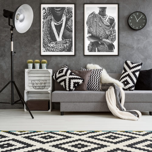 Stylish design of new spacious interior of lounge in big expensive house. Black and white decorations in room